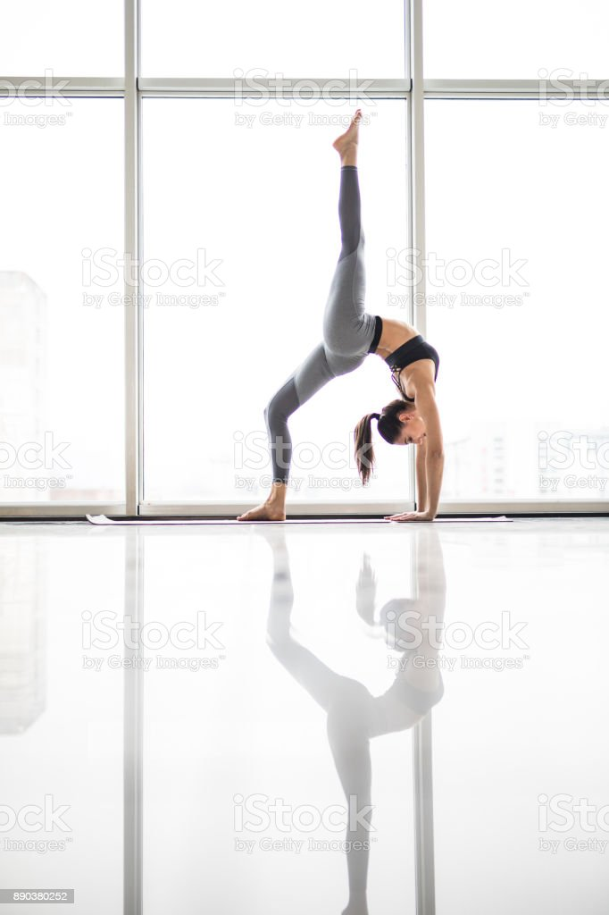 Beautiful yoga woman practice in a training hall background. Yoga concept. stock photo
