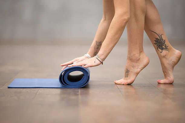 beautiful yogi woman has finished workout - gymnastik tattoo stock-fotos und bilder