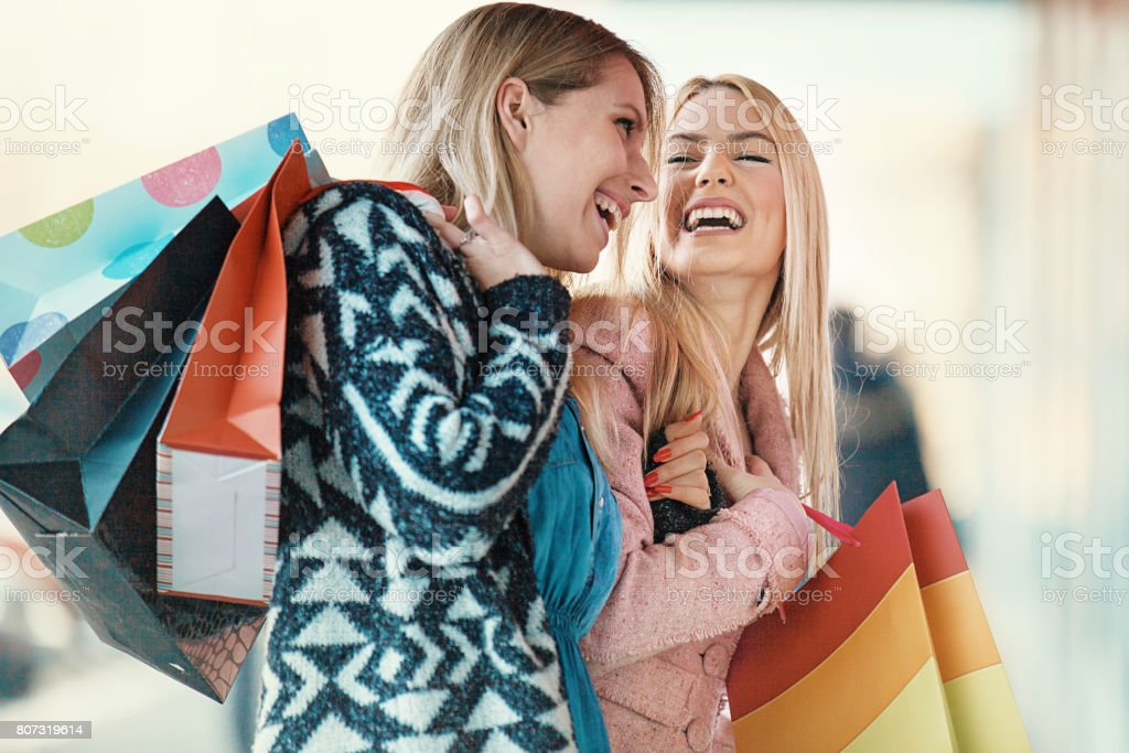 Beautiful youmng woen in shopping. stock photo
