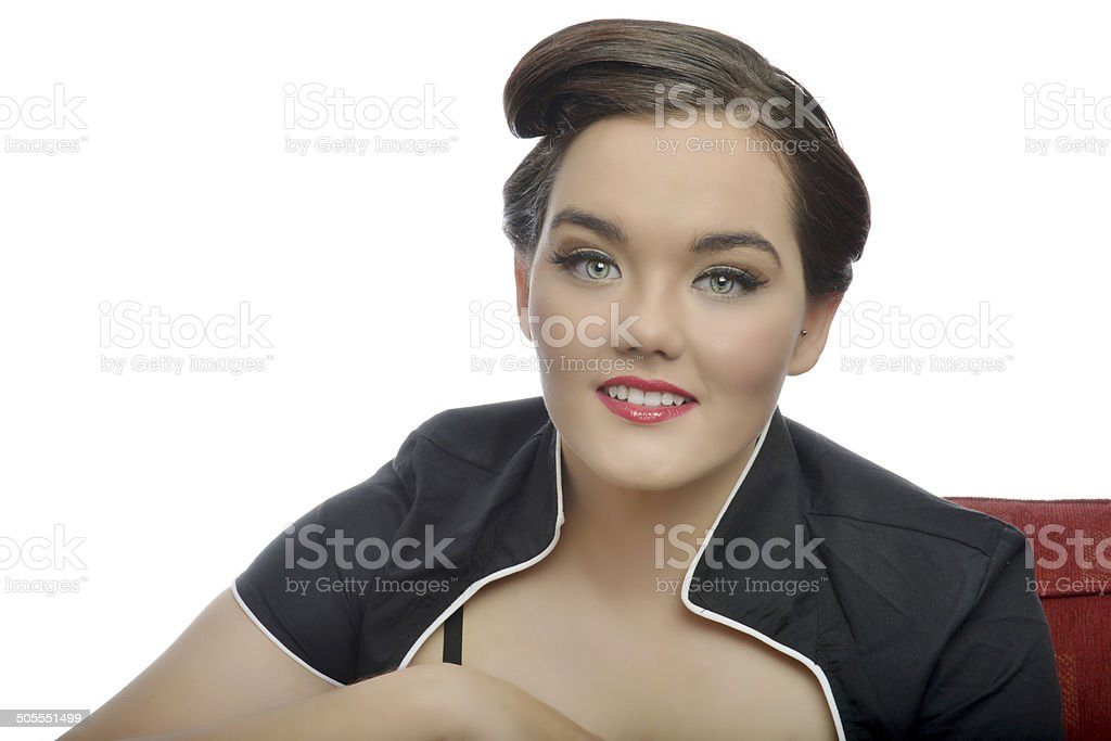 Beautiful young 1950's style pin-up girl with white background stock photo