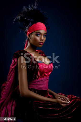 Beautiful young African American woman in regal dress.