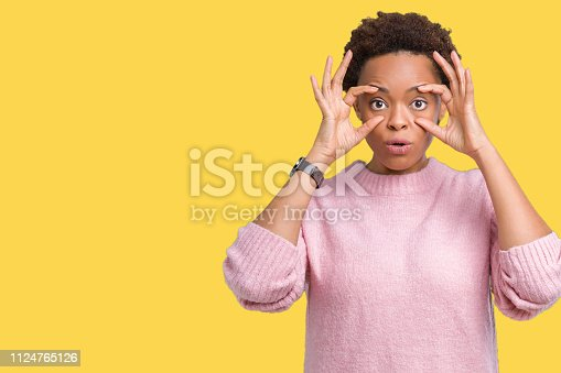 istock Beautiful young african american woman over isolated background Trying to open eyes with fingers, sleepy and tired for morning fatigue 1124765126