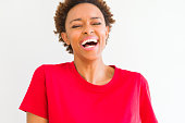 istock Beautiful young african american woman smiling confident to the camera showing teeth over isolated white background 1158252288