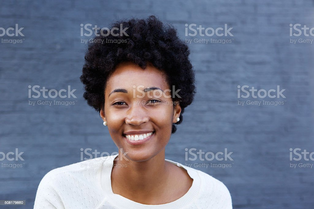 Beautiful young african woman looking happy stock photo