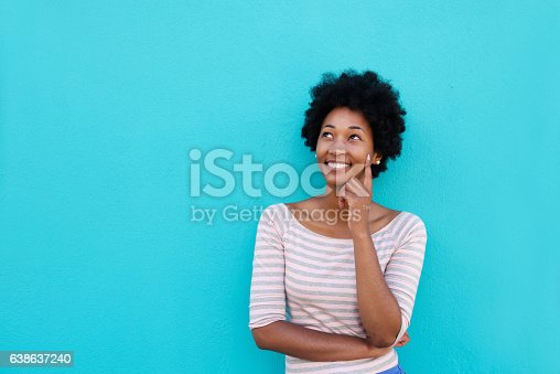 istock Beautiful young african woman smiling and thinking 638637240