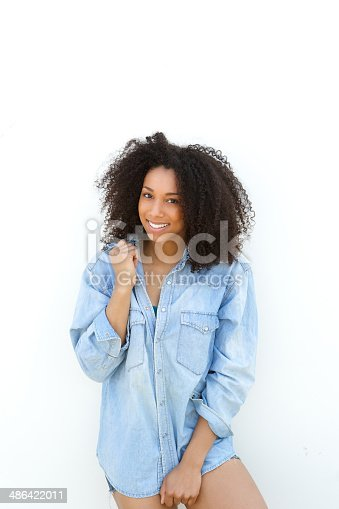 istock Beautiful young african woman smiling 486422011
