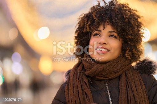istock Beautiful young African-American woman looking away 1005076172