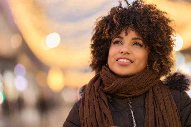 Beautiful young African-American woman looking away stock photo
