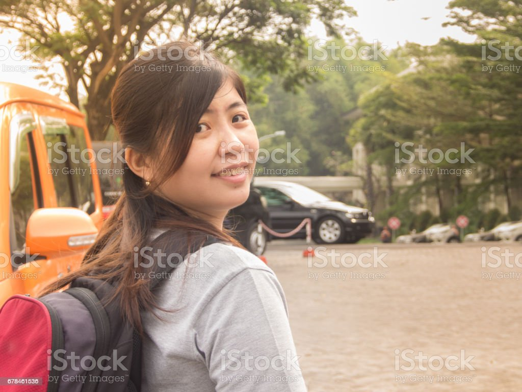 Beautiful Young Asian - Chinese Woman Smiling Going to Travel stock photo
