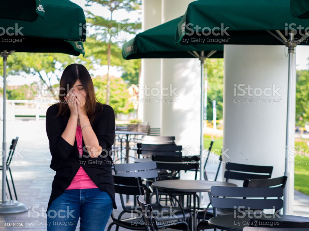 Beautiful Young Asian - Chinese Woman Sneezing / Cough stock photo