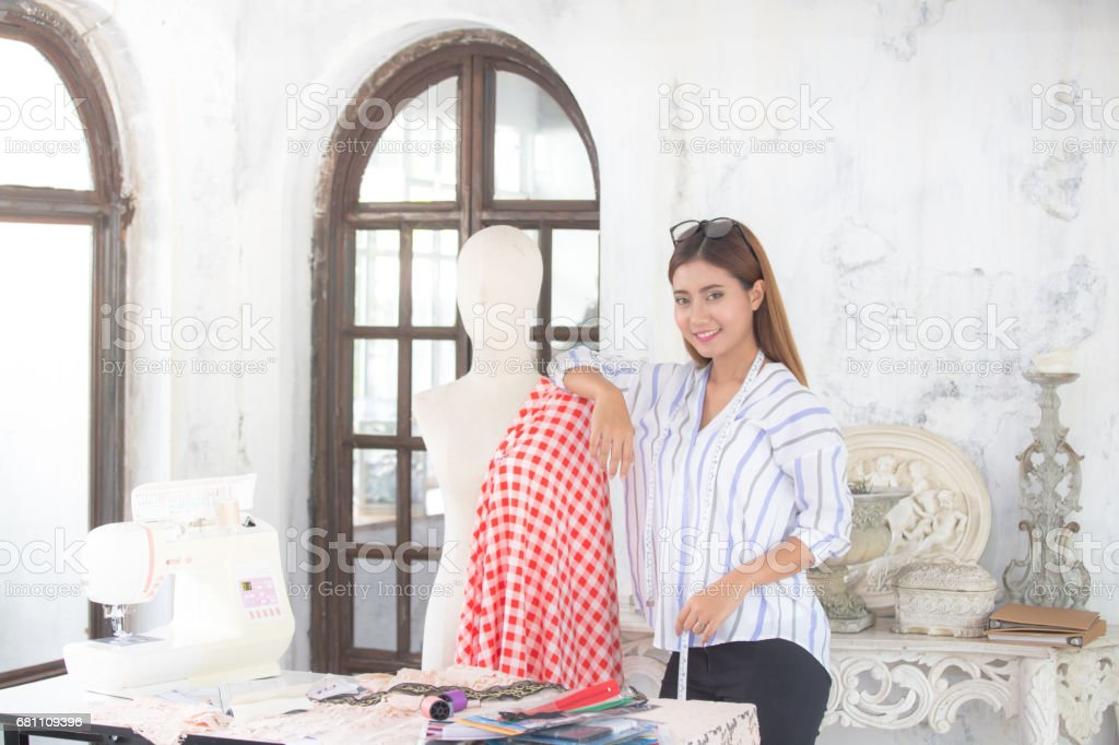 Beautiful young asian designer in her fashion atelier showroom, 20s age royalty-free stock photo