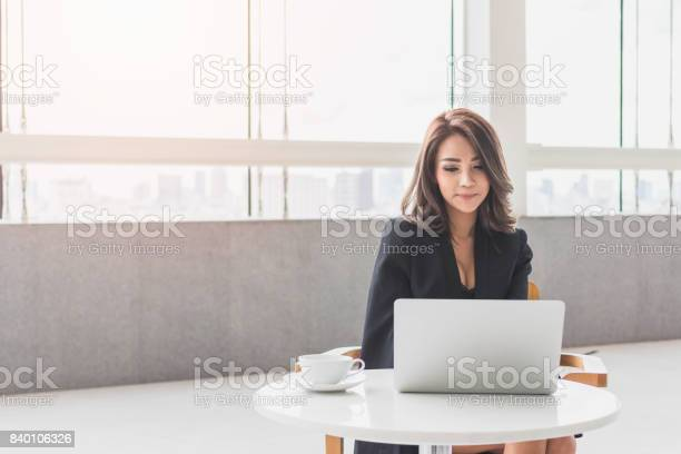 Beautiful young asian girl working at a office space with a laptop picture id840106326?b=1&k=6&m=840106326&s=612x612&h=9omfr90qgzmofk3ulrhudq21cahe77weij9muxtvvxm=