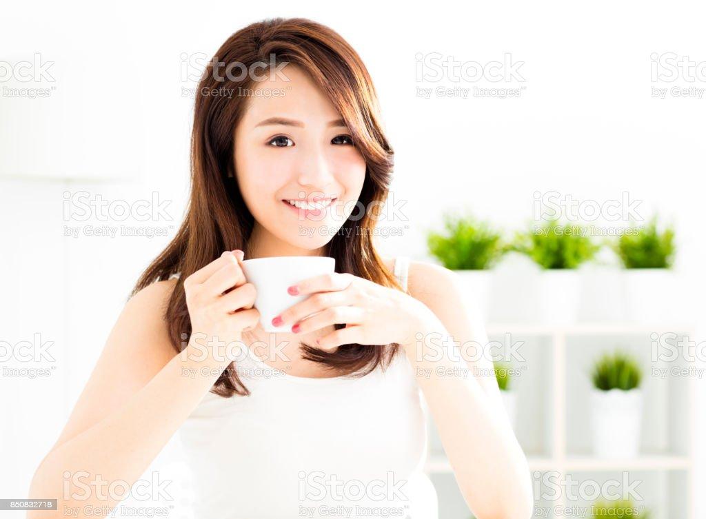 beautiful young asian woman drinking coffee stock photo