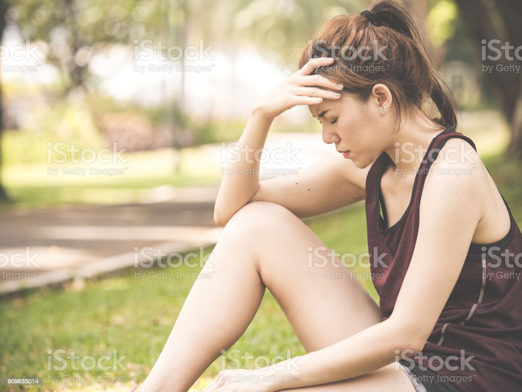 Beautiful young asian woman exhausted from workout running jogging...