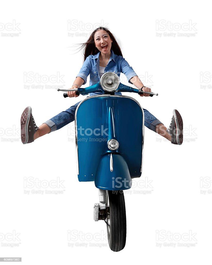 Beautiful young Asian woman riding a motorcycle stock photo