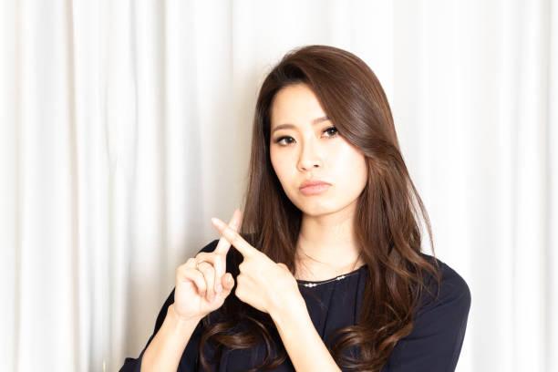 Beautiful young Asian woman say no stock photo