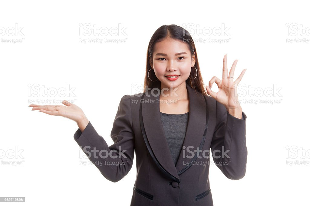 Beautiful young Asian woman show palm hand and OK sign. royalty-free stock photo