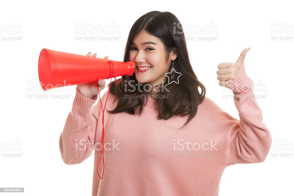 Beautiful young Asian woman show thumbs up announce with megaphone. royalty-free stock photo