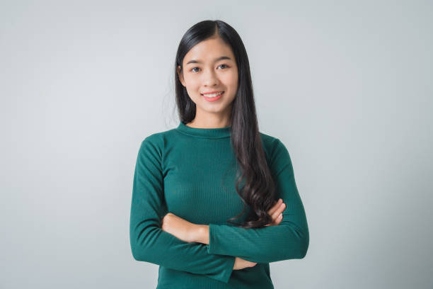 Beautiful young asian woman smiling and looking happily. stock photo