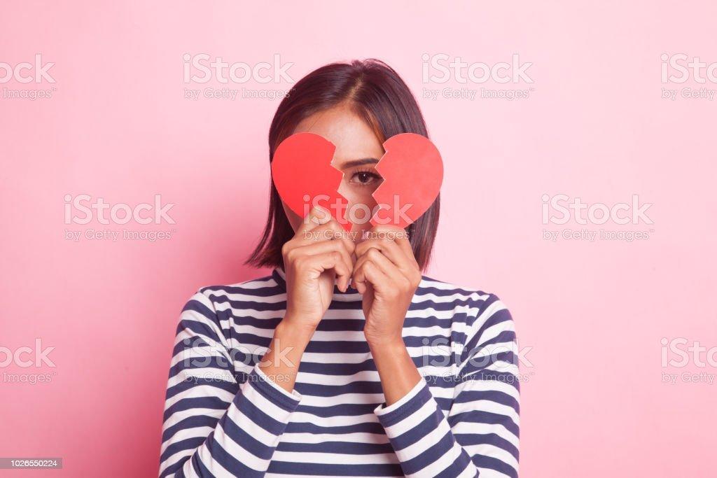 Beautiful young Asian woman with broken heart. stock photo
