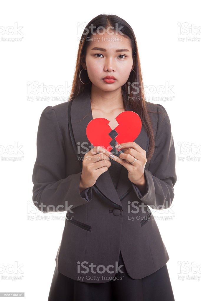 Beautiful young Asian woman with broken heart. royalty-free stock photo