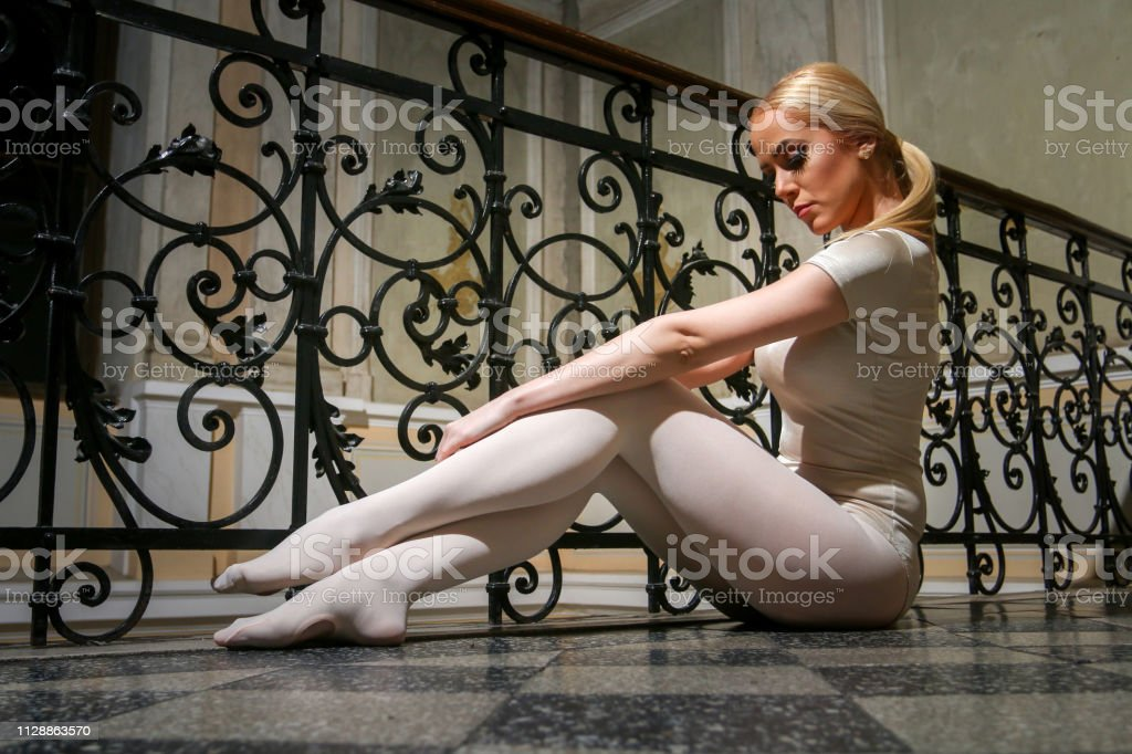 Beautiful Young Ballerina Dancing in Old Building stock photo