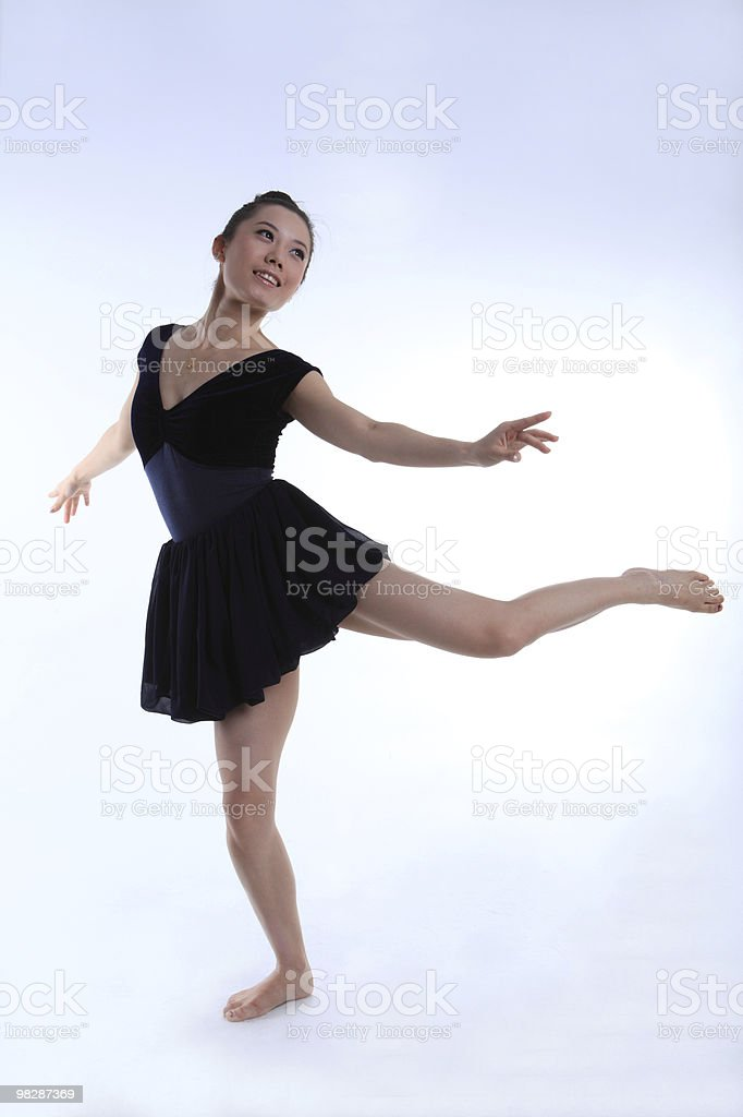 Beautiful young ballet dancer with dancing royalty-free stock photo