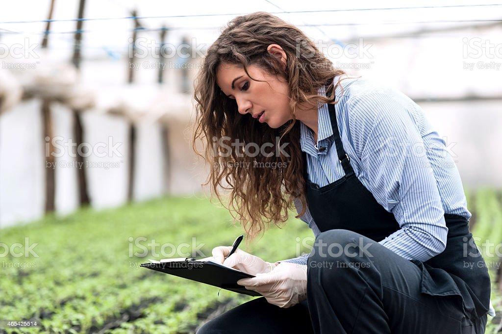 Beautiful young biotechnology woman engineer stock photo