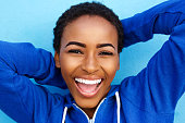 istock beautiful young black girl laughing with hands behind head 857924400