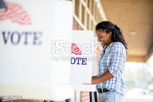 1001757174 istock photo Beautiful Young Black Girl Voting 1001754772