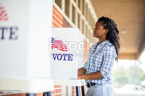 1001757174 istock photo Beautiful Young Black Girl Voting 1001754844