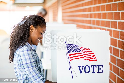 1001757174 istock photo Beautiful Young Black Girl Voting 1001754880