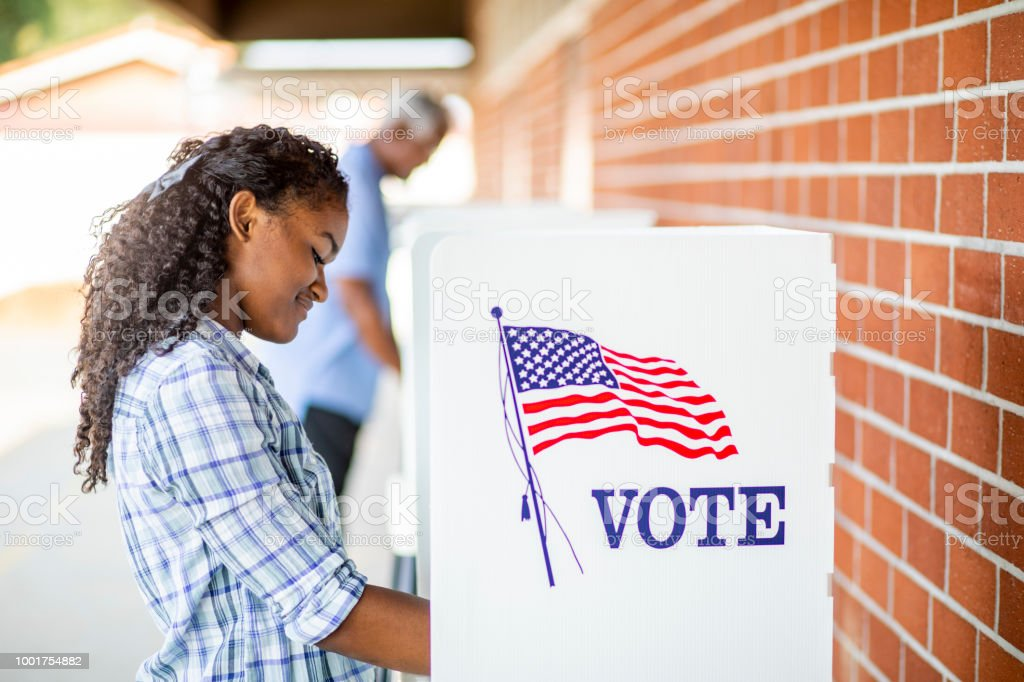 Beautiful Young Black Girl Voting stock photo