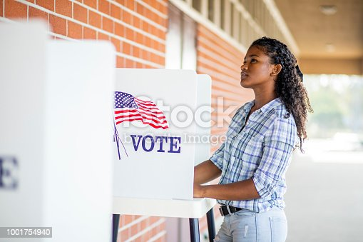 1001757174 istock photo Beautiful Young Black Girl Voting 1001754940