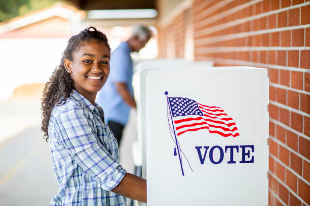 Beautiful Young Black Girl Voting A young black girl voting on election day women's suffrage stock pictures, royalty-free photos & images