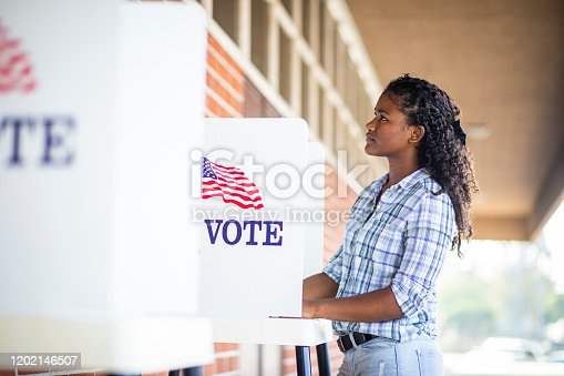 1001754954 istock photo Beautiful Young Black Girl Voting 1202146507