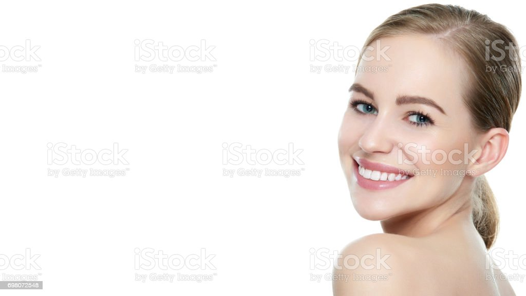 Beautiful young blond smiling woman with perfect white teeth stock photo