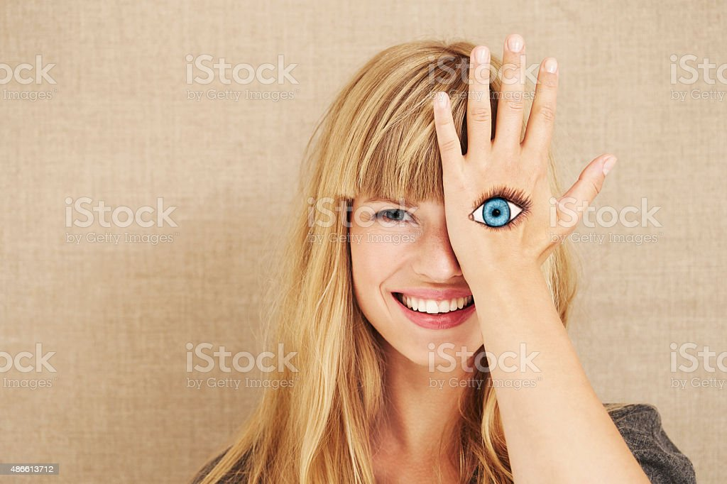 Beautiful young blond with painted eye stock photo