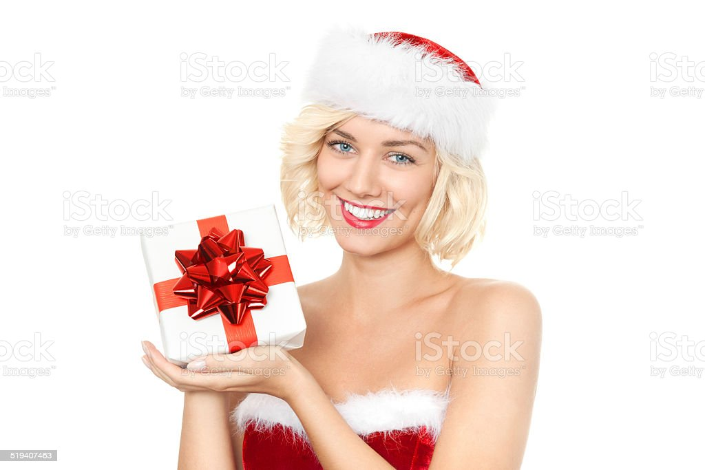 Beautiful young blond woman as santa girl with gift stock photo