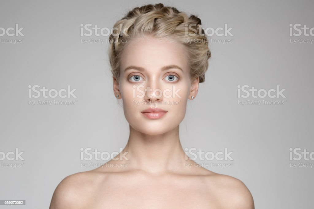 Beautiful Young Blond Woman With Braid Crown Hairstyle stock photo