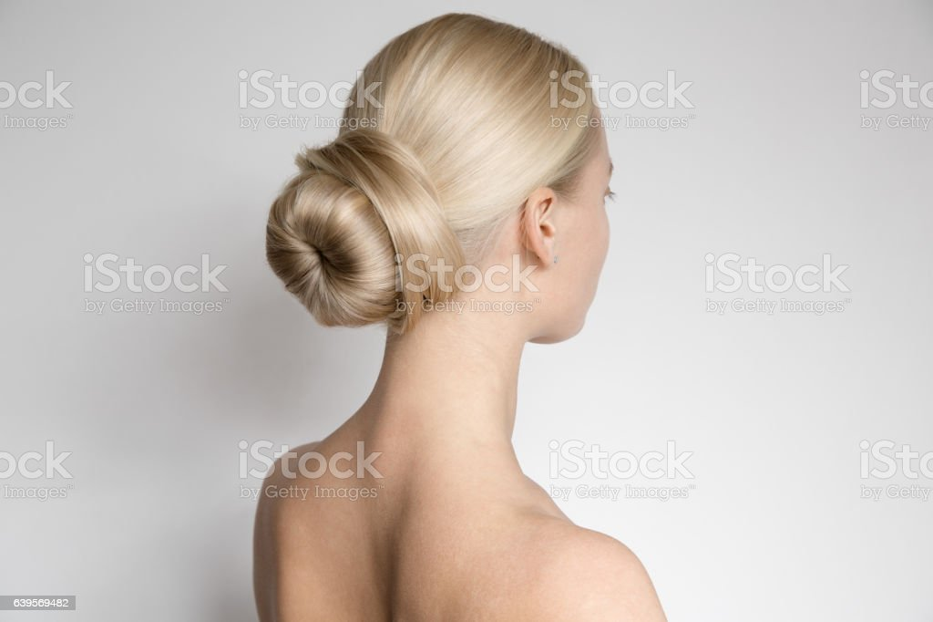 Beautiful Young Blond Woman With Bun Hairstyƒle. Back View stock photo
