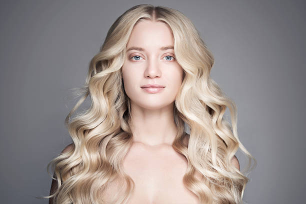 Beautiful Young Blond Woman With Long Wavy Hair. stock photo