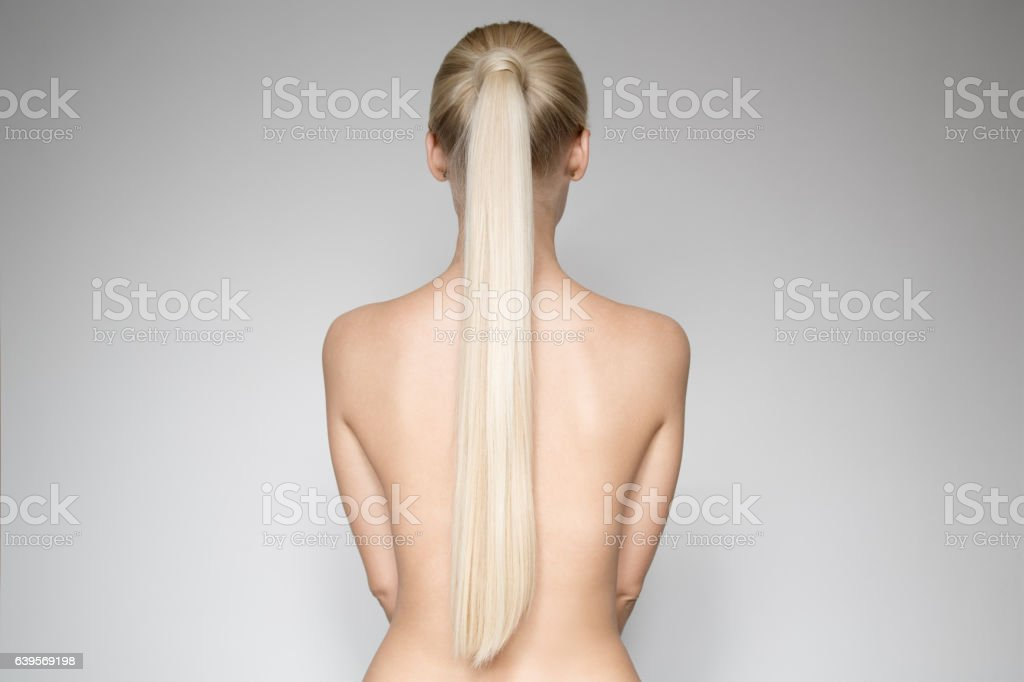 Beautiful Young Blond Woman With Ponytail Hairstyƒle. Back view stock photo