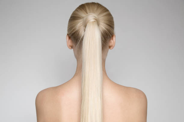 Beautiful Young Blond Woman With Ponytail Hairstyƒle. Back view - foto stock