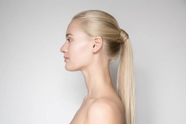 Beautiful Young Blond Woman With Ponytail Hairstyƒle. Side View stock photo