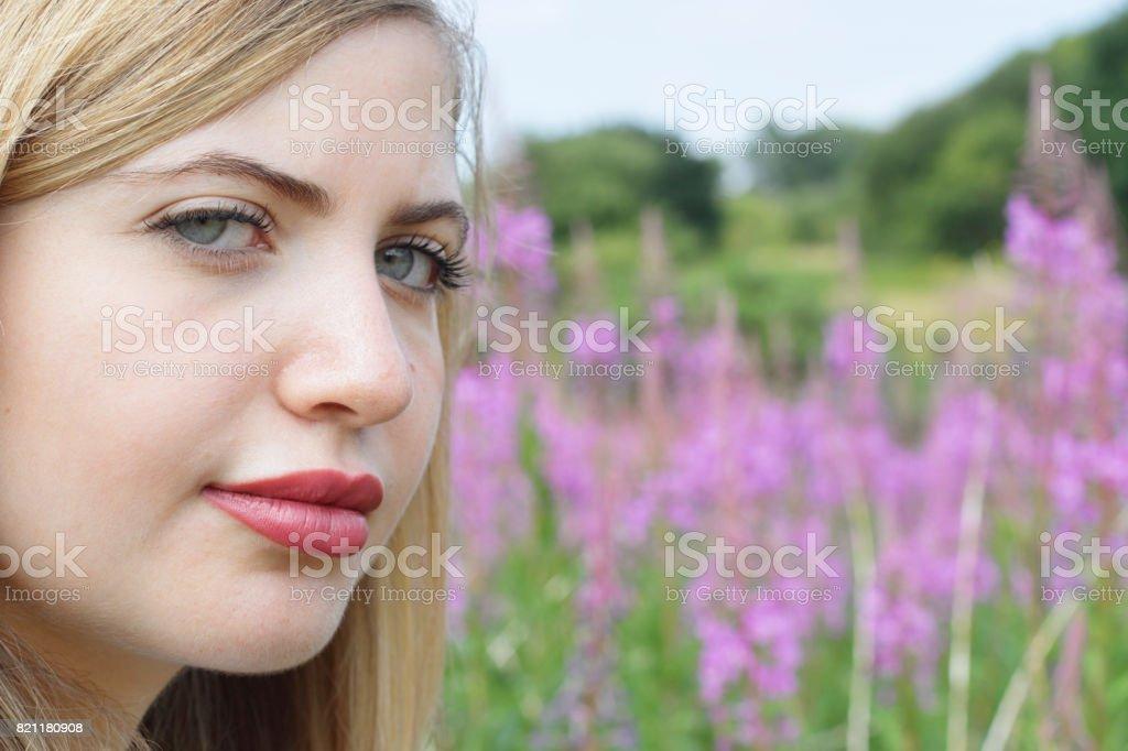 Beautiful young blonde Bulgarian outdoor girl grey eyes stock photo