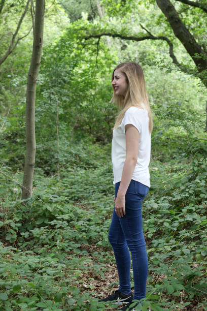 beautiful young blonde bulgarian outdoor girl in woodland - whiteway english outdoor girl stock photos and pictures