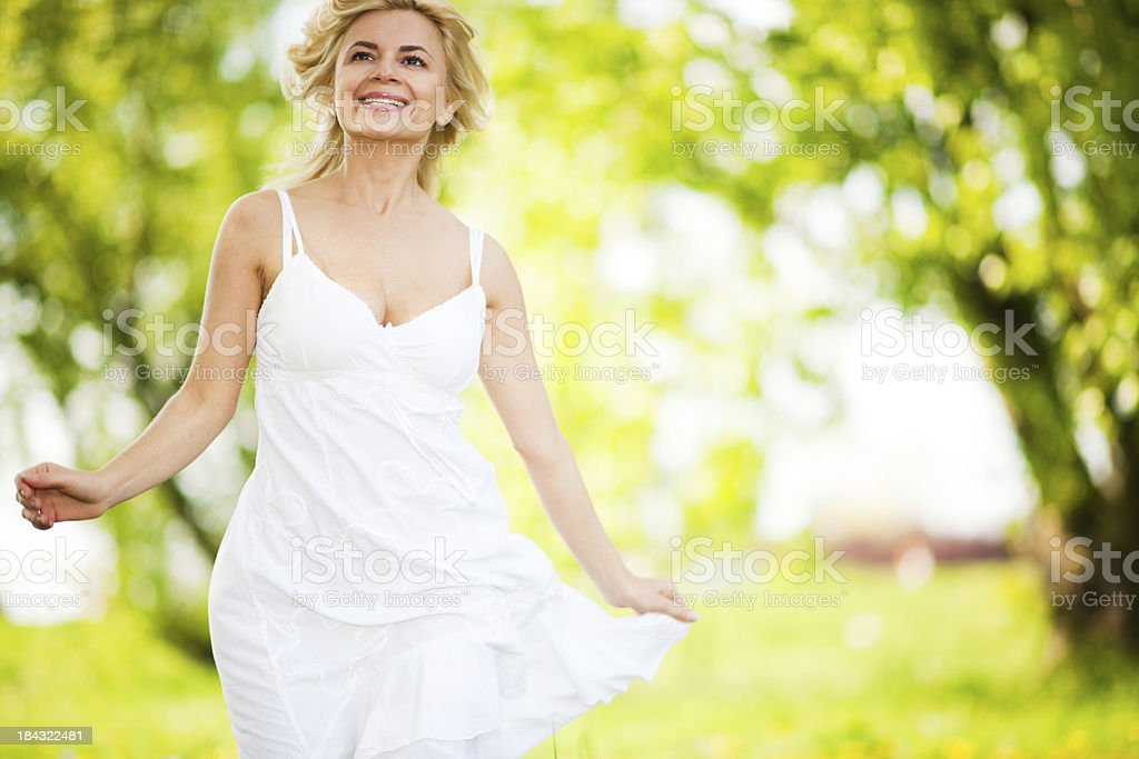Beautiful young blonde running in the park. royalty-free stock photo