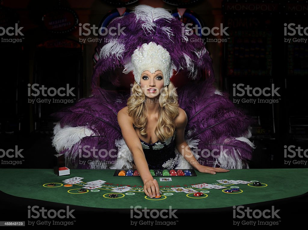 Beautiful young blonde Showgirl dealing Blackjack stock photo