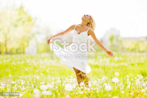 istock Beautiful young blonde standing in the park. 170215338